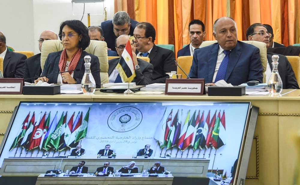 Egyptian Foreign Minister Sameh Shoukry (R) and Mounia Boucetta (L), Morocco's Secretary of State for Foreign Affairs and International Cooperation, attend the preparatory meeting for Arab League foreign ministers in Tunis on March 29, 2019 ahead of the 30th annual Arab League summit. (Photo by FETHI BELAID / AFP)