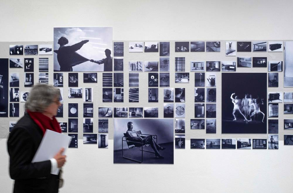 Photographs depicting life at the bauhaus are on display at the new Bauhaus museum in Weimar, eastern Germany, on April 4, 2019. - The Bauhaus design school, which transformed the way people around the world live, work and dream of the future, marks its centenary with the launch of the politically charged museum on April 6, 2019. The sprawling museum in Bauhaus's birthplace of Weimar, a small city 250 kilometres (150 miles) southwest of Berlin, will display the classics of its less-is-more, form-follows-function aesthetic. (Photo by John MACDOUGALL / AFP) / RESTRICTED TO EDITORIAL USE -  MANDATORY MENTION OF THE ARTIST IN THE CAPTION  - TO ILLUSTRATE THE EVENT AS SPECIFIED IN THE CAPTION