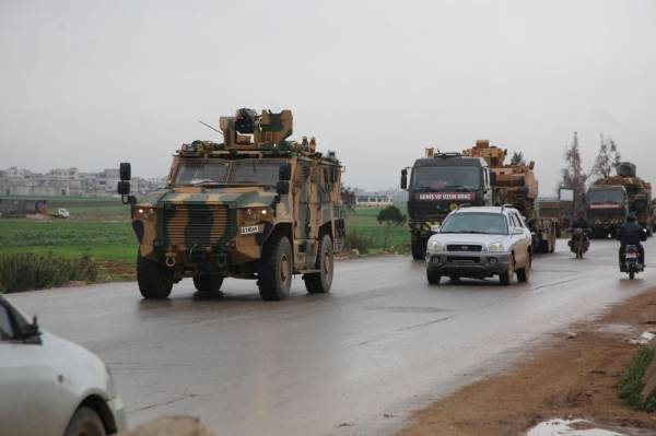 A Turkish military convoy drives on a highway linking Idlib to the Syrian Bab al-Hawa border crossing with Turkey on March 31, 2020. (Photo by Mohammed AL-RIFAI / AFP)