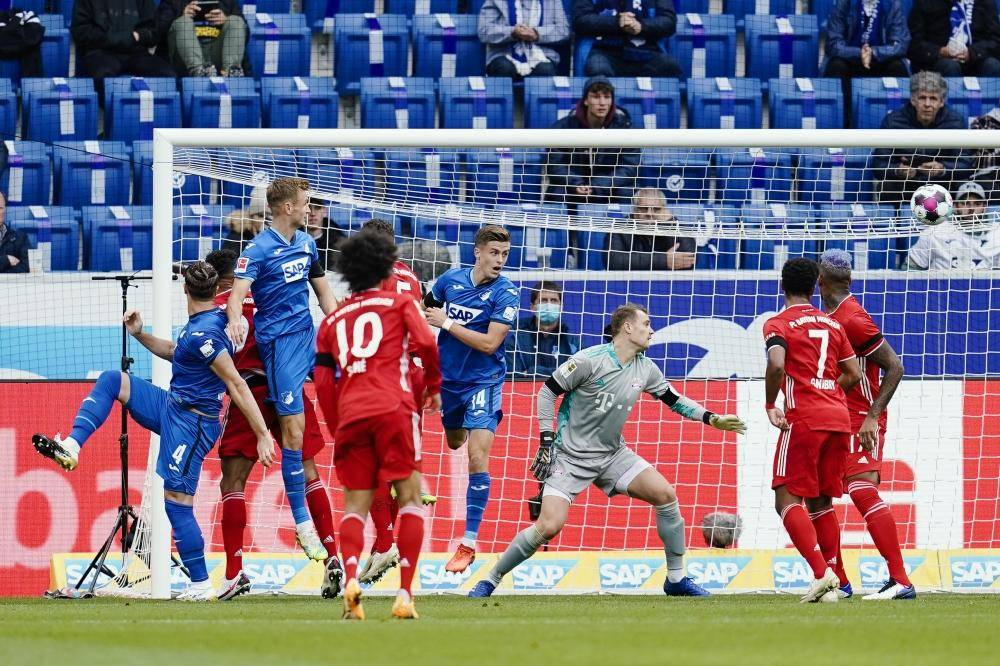 27 September 2020, Baden-Wuerttemberg, Sinsheim: Hoffenheim's Ermin Bicakcic scores his side's first goal past Munich goalkeeper Manuel Neuer during the Germn Bundesliga soccer match between 1899 Hoffenheim and Bayern Munich at the PreZero-Arena. Photo: Uwe Anspach/dpa - IMPORTANT NOTICE: DFL and DFB regulations prohibit any use of photographs as image sequences and/or quasi-video.