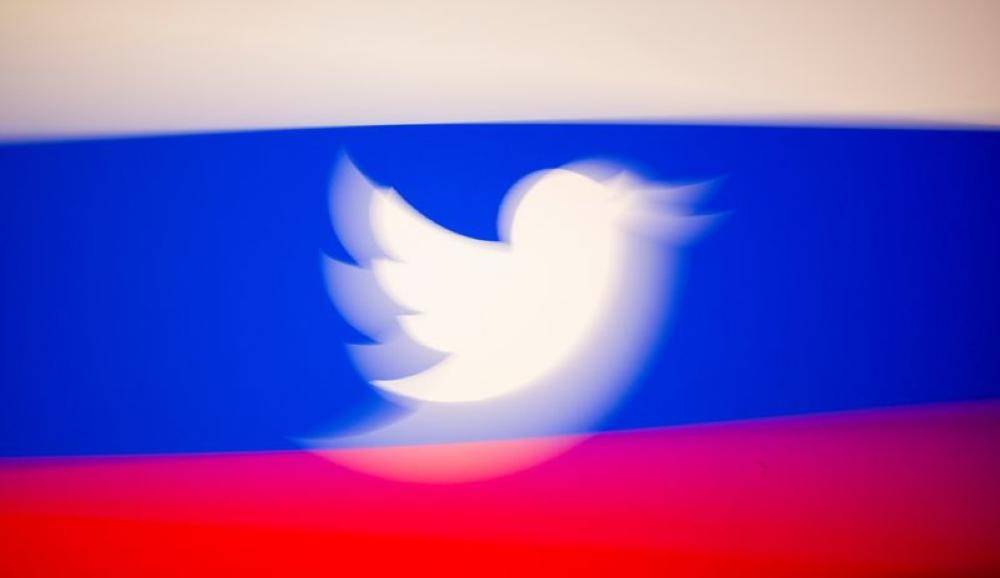 Twitter logo and a Russian flag are displayed in this illustration picture taken March 10, 2021. REUTERS/Dado Ruvic/Illustration