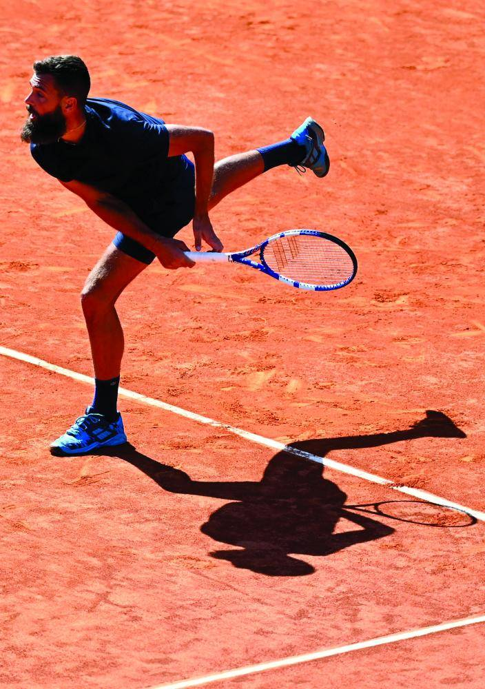 France's Benoit Paire serves to Georgia's Nikoloz Basilashvili during their 2021 ATP Tour Madrid Open tennis tournament singles match at the Caja Magica in Madrid on May 4, 2021. (Photo by GABRIEL BOUYS / AFP)