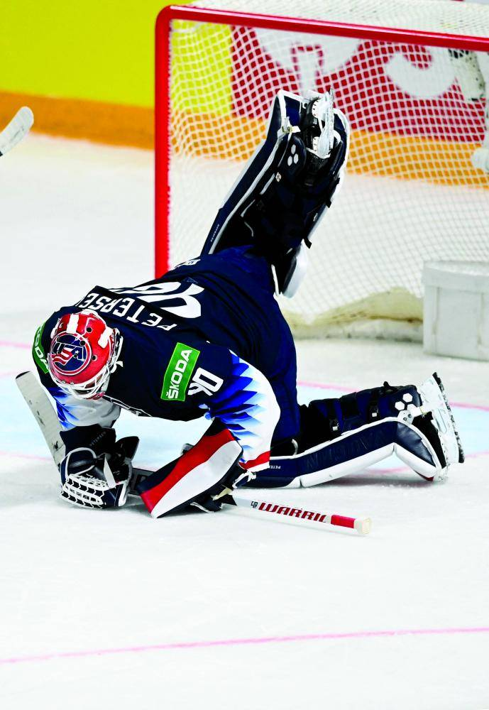 US' goalkeeper Calvin Petersen makes a save during the IIHF Men's Ice Hockey World Championships preliminary round group B game between USA and Kazakhstan at the Arena Riga in Riga, Latvia, on May 25, 2021. (Photo by Gints IVUSKANS / AFP)