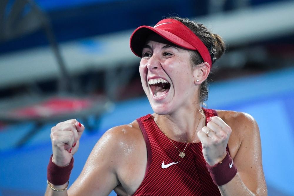 Switzerland's Belinda Bencic celebrates after defeating Czech Republic's Marketa Vondrousova during their Tokyo 2020 Olympic Games women's singles tennis final match at the Ariake Tennis Park in Tokyo on July 31, 2021. (Photo by Tiziana FABI / AFP)