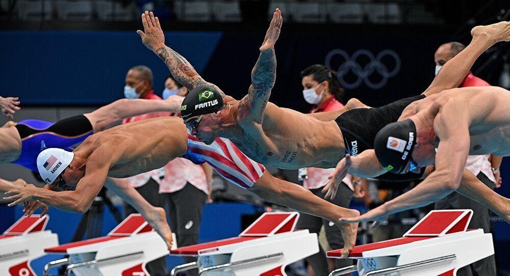 لماذا يرتدي السباحون الأولمبيون قبعتين
