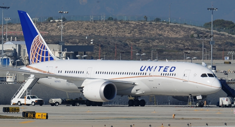 (FILES) In this file photo taken on January 17, 2013 a grounded United Boeing 787 Dreamliner is seen on the tarmac at Los Angeles International Airport. - United Continental still expects to receive new Boeing 737 MAX planes in 2019 and does not expect a fight with the manufacturer over recovering costs from the planes' grounding, United executives said on April 17, 2019. Boeing's 737 MAX planes have been grounded globally since mid-March following two deadly crashes involving the planes in less than five months. (Photo by Robyn BECK / AFP)