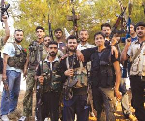 الجيش الحر يتبرأ من المقاتلين الأجانب  ويطالبهم با